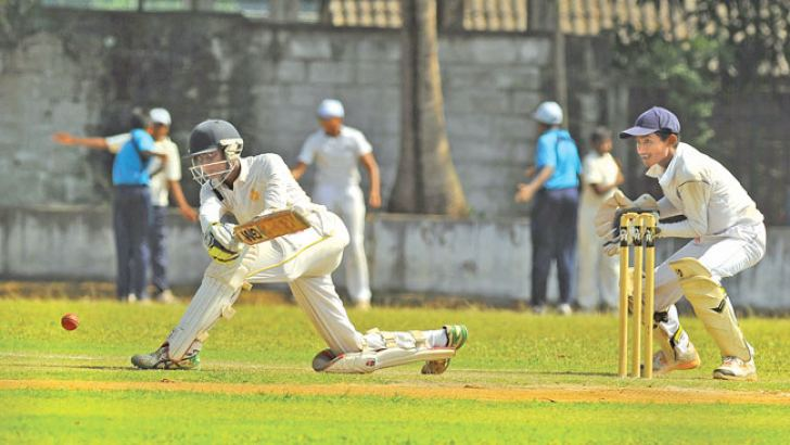 Royal batsman Malith Kariyawasam sweeps for runs during his knock of 37 on the first day of the inter-school cricket match against Wesley at Campbell Park yesterday. Picture by Thilak Perera
