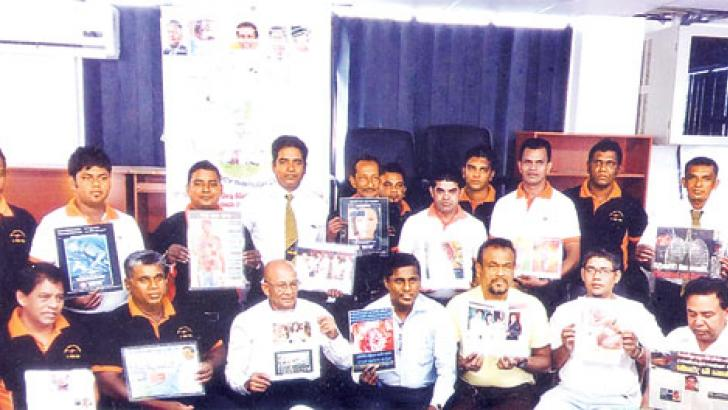 M.D.Karunadasa with a group of disciplined drivers who attended a programme to promote a group of liquor and drug free star class drivers.
