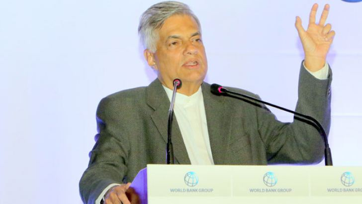 Prime Minister Ranil Wickremesinghe addressing an event at the Ape Gama premises to launch the World Bank reports. Picture by Saman Sri Wedage