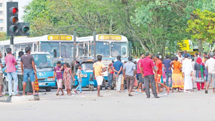 The traffic congestion caused at Grand pass in Colombo due to a protest carried out by a group of people near the Bridge across the Kelani river, against the removal of unauthorized structures.