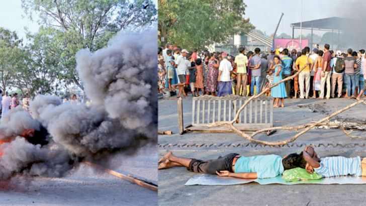 Protestors at Thotalanaga lying on the road in protest. Pictures by Saman Sri Wedage