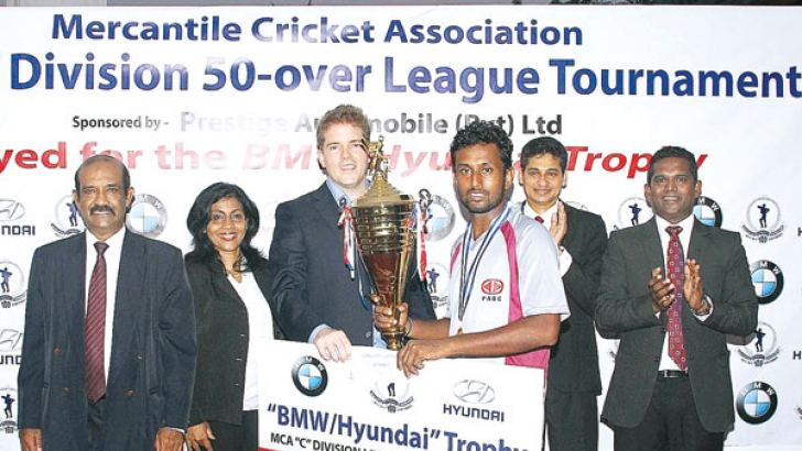 Winning captain of PABC, Buddhika de Alwis (third from right) receiving the BMW-Hyundai Cup from Chief Guest, Director, Prestige Automobile (Pvt) Ltd., Christian Reuter (third from left). MCA General Secretary, Nalin Wickramasinghe, Viola Karunaratne, Director Prestige Automobile (Pvt) Ltd., President, Niran Mahawatte and Secretary, Tournament Committee, Sanjaya Wijesinghe both from MCA are also present.