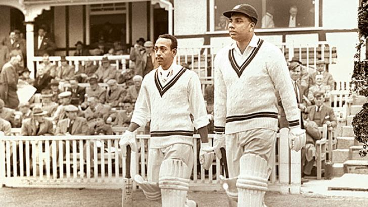 Andy Ganteaume, left, walks out to bat with Clyde Walcott in the 1957 West Indies tour match against Worcestershire at Worcester.