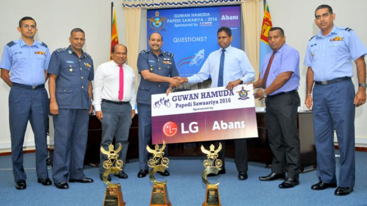 Abans Group of Companies General Manager Ajith Priyashantha hands over the sponsorship cheque to Air Vice Marshal DLS Dias (Chairman – SLAF Cycling). Group Captain PN De Costa (Secretary, SLAF Sports Council), Group Captain LMSK Leelaratne (Secretary, SLAF Cycling), Dr. Amal Harsha de Silva (President – Sri Lanka Cycle Federation), Lalin Anthony (Deputy General Manager – Abans Group) and Air Commodore WLG Rodrigo (Command Sport Officer – SLAF) are also present Picture by Rukmal Gamage