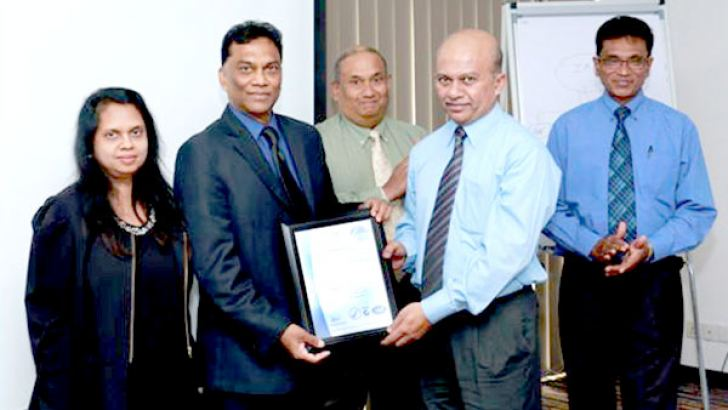 Presenting a certificate to one of their Clients, Freight Links International. Samanthie Fernando, BCert Director, Samath Fernando, BCert Director, Dr. Manthinda Hettiarachchi, Technical expert, Varuna Ratnaweera, Freight Links International QA Director, Nihal Wanniarachchi, BCert Marketing Manager at the event.