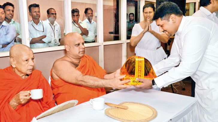 A pirith pinkama was held at Lake House on Tuesday followed by a sanghika dana yesterday to mark the 130th birth anniversary of its founder D. R. Wijewardene. Here, Defence State Minister Ruwan Wijewardene offering an Ata pirikara to the Maha Sangha. The Senior Management of the ANCL led by Chairman Kavan Ratnayake were present. Picture by Wimal Karunathilake