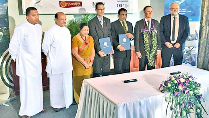 New Zealand Prime Minister John Key, Central Province Governor Suranganie Ellawala and Chief Minister Sarath Ekanayake and others after the signing of the five-year 202 million rupees partnership funded by the New Zealand  Aid Programme to increase the number of trained veterinarians in  Sri Lanka in an effort to boost milk yields and in turn, supplement  farmer incomes.