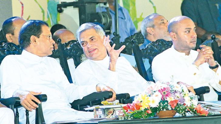 President  Maithripala Sirisena, Prime Minister Ranil Wickremesinghe and Agriculture Minister Duminda Dissanayake at the ceremony yesterday. Picture by Sudath Malaweera