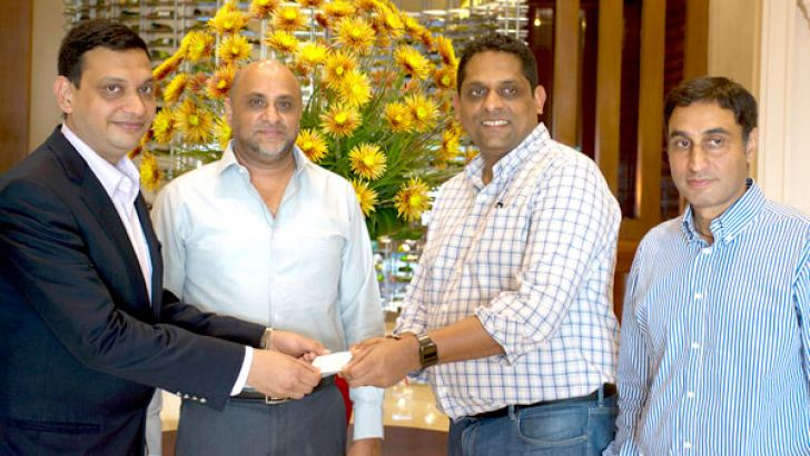 The Silver sponsorship being handed over by Anil - Gautam, Business Head Wipro UNZA, to Nathan Sivagananathan- Co-founder of Trail.  Looked on by Udaya Nissanka Managing Director of U T N Trading Co and  Ravi Katoch, Country Manager Sri Lanka, Wipro Entp Pvt Ltd.