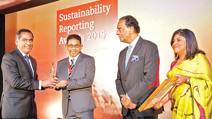 Sampath Bank  Chief Operating Officer Nanda Fernando, receiving the award from  President  ACCA Sri Lanka  Dhanushka Samarasnghe with  Minister of Prison Reforms, Rehabilitation, Resettlement and  Hindu Religious Affairs D.M. Swaminathan and  ACCA Sri Lanka Country Head Nilusha Ranasinghe.