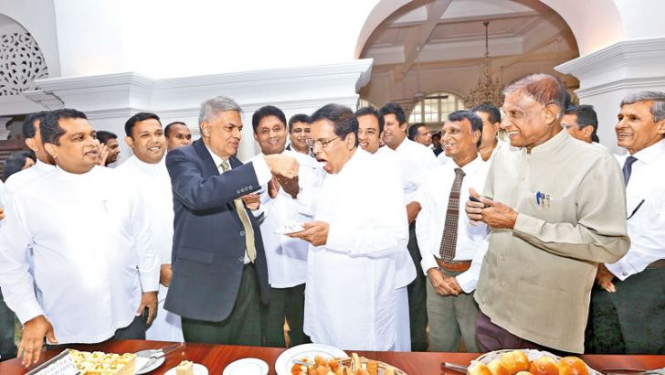 President Maithripala Sirisena was among those who called over at Temple Trees yesterday to wish Prime Minister Ranil Wickremesinghe a happy birthday. Here, President Sirisena is being fed a piece of birthday cake by Prime Minister Wickremesinghe. Minister Sajith Premadasa and Parliamentarian Harshana Rajakaruna are also in the picture.
