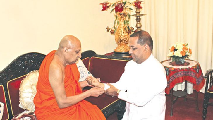 Fisheries and Aquatic Resources Minister and UPFA General Secretary Mahinda Amaraweera yesterday, called on the Mahanayake of Thera of the Malwatte Chapter Most Ven. Thibbotuwawe Sri Sumangala Thera and received his blessings. Picture by Asela Kuruluwansa