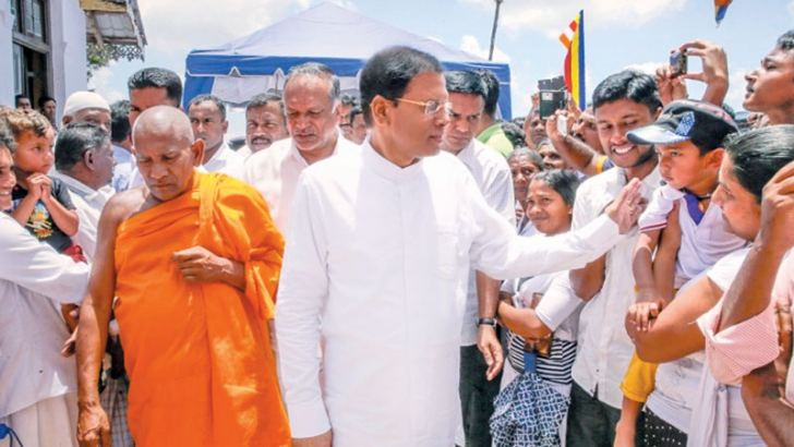 President Maithripala Sirisena arriving at the Sri Sankagiri Temple in Welimada to participate in an opening ceremony of a newly built 'Vahalkada' at the temple on Monday