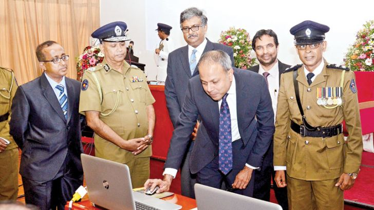 Law and Order and Southern Development Minister Sagala Ratnayaka launching the Crimes Intelligence Data Analysis System at the BMICH Monday. Law and Order Ministry Secretary Jagath P.Wijeweera, Sri Jayawardanapura University Vice Chancellor Prof. Sampath Amaratunga and Inspector General of Police N.K. Illangakoon were also present. Picture by Wimal Karunathilaka