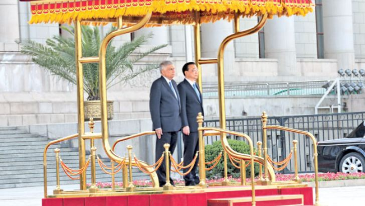 Prime Minister Ranil Wickremesinghe and the delegation from Sri Lanka were welcomed with a Guard of Honour at the Great Hall of the People in Beijing by China Prime Minister Li Keqiang and other dignitaries.