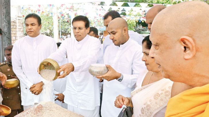 President Maithripala Sirisena presided over the Aluth Sahal Mangalya, offering the maiden rice gathered fresh from the field to the sacred Sri Maha Bodhiya in Anuradhapura yesterday morning. Thousands of farmers from across the island including the former war battered northern and eastern provinces gathered near the sacred Sri Maha Bodhiya for the event. The objectives of the ritual practiced since ancient times is to invoke blessings on the deities for the success of the paddy cultivation and for adequate