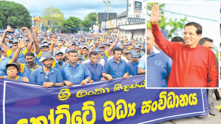 President Maithripala Sirisena greets the crowd at the SLFP and UPFA May Day rally in Galle yesterday. Pictures by Sudath Malaweera and Rukmal Gamage
