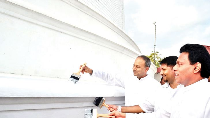 Law and Order and Southern Development Minister and Prime Minister's Chief of Staff Sagala Ratnayake, Defence State Minister Ruwan Wijewardene and NCP Chief Minister Peshala Jayaratne initiating the repainting of the Mihintale Maha Seya.  Pictures by Hidogama Group, Chitrarathna Kaluarachchi