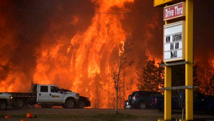 The Canadian city of Fort McMurray remained under threat from catastrophic wildfires Wednesday.