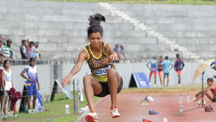 Vidusha Lakshani on her way to set up a record  in the Under-23 Triple Jump event