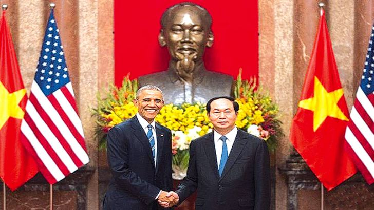 US President Barack Obama (L) shakes hands with Vietnamese President Tran Dai Quang during his visit to the Presidential Palace in Hanoi yesterday. - AFP
