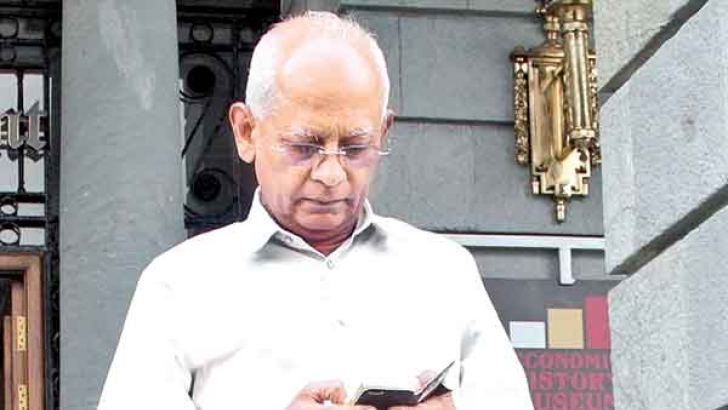Former Secretary to the President Lalith Weeratunga leaving the  Financial Crimes Investigations Division (FCID) of Police last  morning.