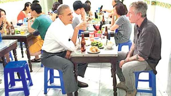 US President Barack Obama slipped away from his hectic Vietnam visit on Monday night to sample some food with CNN's Anthony Bourdain.