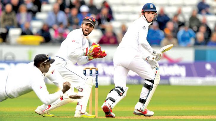 Sri Lanka captain Angelo Mathews pulls off a blinder of a catch at slip to send back England opener Alex Hales for 83 on the opening day of the second Test at Chester-le-Street, Durham on Friday. AFP