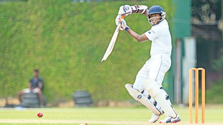 Opening bat Vishva Chathuranga who top scored for Sri Lanka with a patient 81 plays a shot off the back foot on the second day of the first under 19 test against South Africa at the P Sara Oval yesterday. (Pix by Rukmal Gamage)