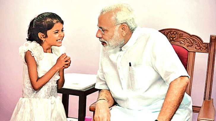 PM Narendra Modi with young Vaishali in Pune.