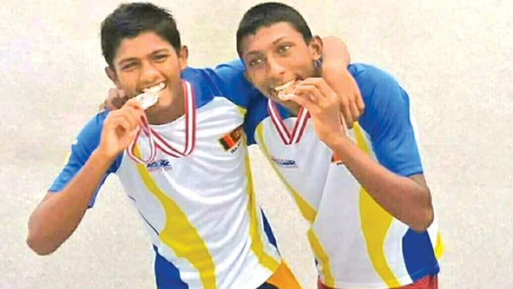 Overall champion Dulanjan Fernando (on left) and Prasad Dissanayake proudly display their medals