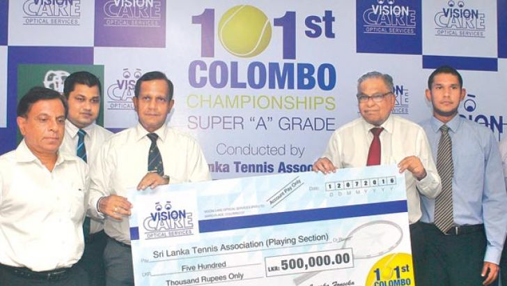 Vision Care Managing Director Janaka Fonseka handing over the sponsorship cheque to SLTA Playing Section President Asoka Abeywardena at the press conference held at SLTA yesterday. Picture by Siripala Halwala