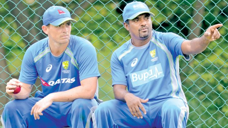 Sri Lanka bowling legend Muthiah Muralitharan with Australian spinner Steve O'Keefe during practice at Pallekele Stadium yesterday. Pic by Lakruwan Wanniarachchi, AFP