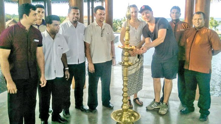 Anantaya Pasikudah staff welcoming the first guests by lighting the traditional oil lamp