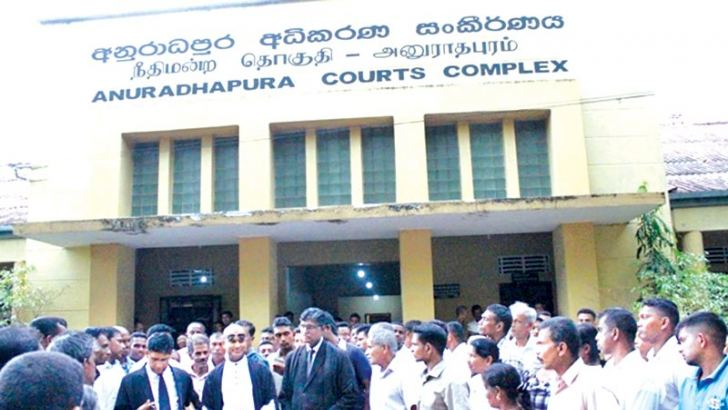 The acquitted six respondents with their relatives and lawyers, after the judgment. Picture by Anuradhapura Central Special Corr