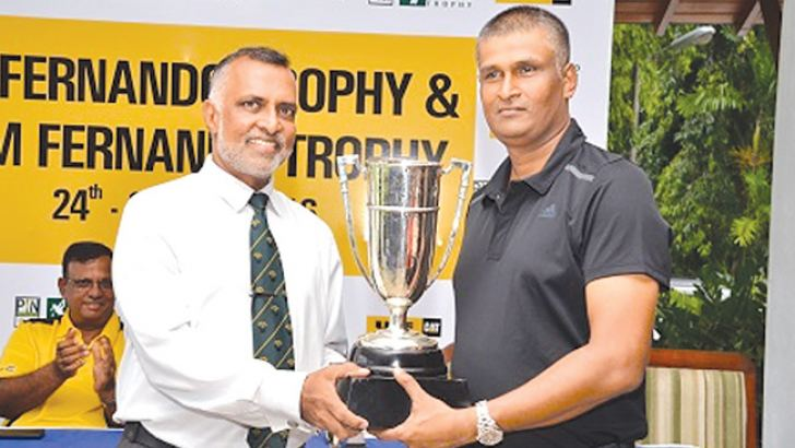 The winner of the Pin Fernando Trophy Sudath Kumar receiving the Trophy   from Primal Wijayanayake, captain of the Royal Colombo Golf Club.