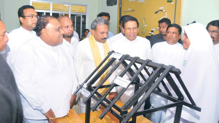 President Maithripala Sirisena viewing one of the exhibits on display at Galle Malharu Sulhiya National School after opening  a technological laboratory. Picture by Sudath Malaweera