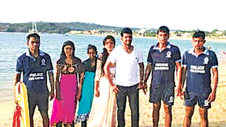 The couple with officers of the Police Life Saving Unit who rescued them. Picture Trincomalee special corr