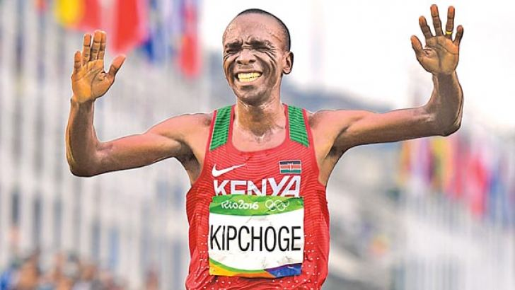 Kenya's Eliud Kipchoge celebrates after winning the Men's Marathon athletics event of the Rio 2016 Olympic Games at the Sambodromo in Rio de Janeiro on August 21. AFP