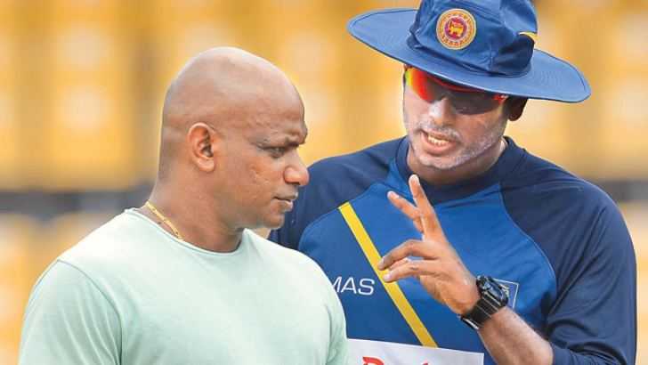 Sri Lanka captain Angelo Mathews in conversation with chief selector Sanath Jayasuriya during practice at the R Premadasa Stadium yesterday.  Pictures by Rukmal Gamage.
