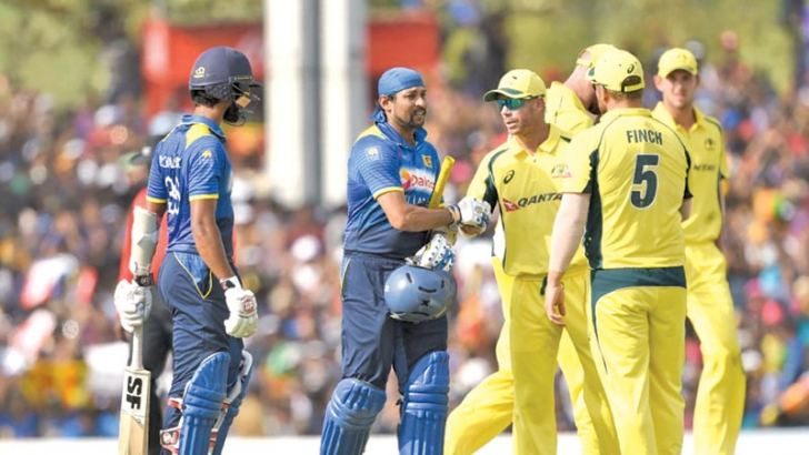 Australian players shake hands with Tillakaratne Dilshan after his final ODI innings at the Rangiri Dambulla Stadium on Sunday.