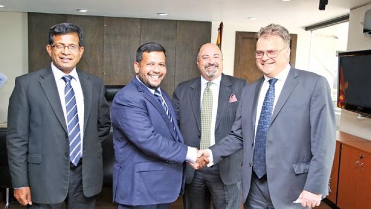 Minister of Industry and Commerce Rishad Bathiudeen joined by Ministry Secretary TMKB Thennakoon  greets the  visiting Assistant U.S. Trade Representative for South Asia Michael J.  Delaney  as U.S. Ambassador to Sri Lanka and Maldives Atul Keshap looks on in Colombo yesterday.