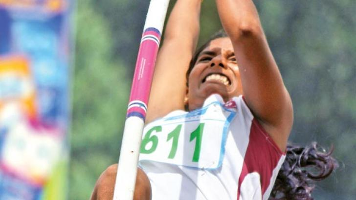 J Anitha of Mahajana College, Thelippalai competes in the Girls Under-20 Pole Vault final, where she established a new Sri Lanka record. Pictures by Nirosh Batepola