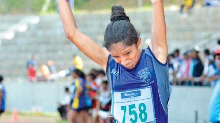 Ridma Nishadi of Dharmasoka College Ambalangoda sets up a new meet record in the Girls Under-16 Triple Jump final on the second day of the 86th Sir John Tarbet Senior Athletics Championships at Diyagama yesterday. Picture by Sulochana Gamage