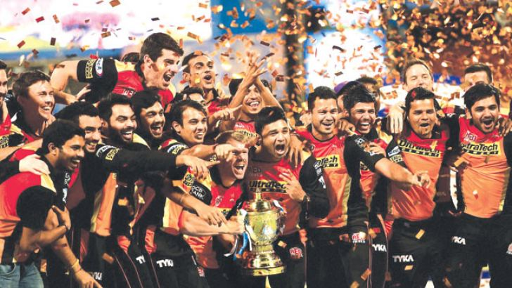 Sunrisers Hyderabad players celebrate with the winning trophy of IPL 2016 after beating Royal Challengers Bangalore in the final match at Chinnaswamy Stadium in Bengaluru. PTI Photo by Shailendra Bhojak