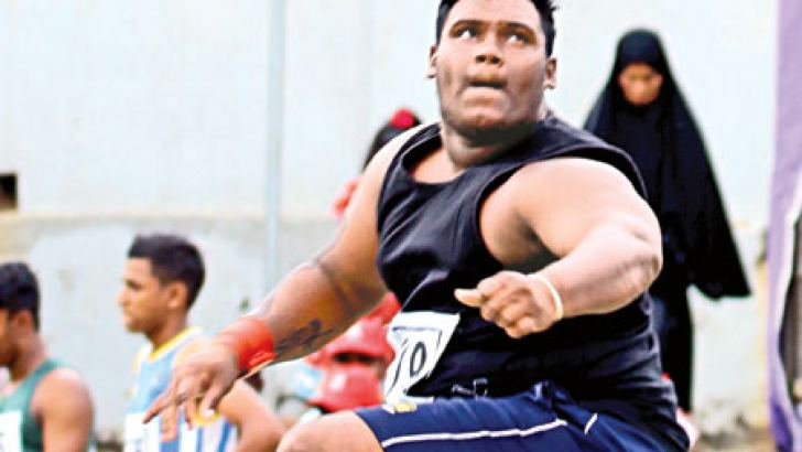 WMAM Madusanka of Puttalam District set up a new meet record of 16.13 metres in the under 20 Shot Putt event. Pic by Ranjith Asanka