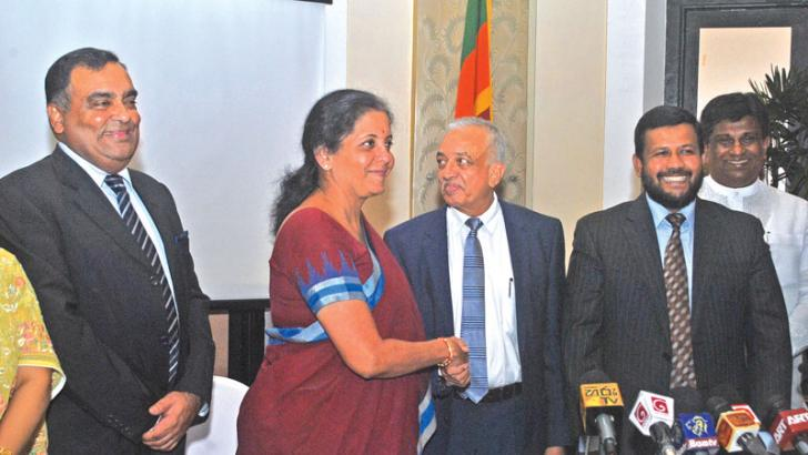 Indian Minister for State(IC) Commerce and Industry of India Nirmala Seetharaman with Minister for Development Strategies and International Trade Malik Samarawickrama. Picture by Siripala Halwala