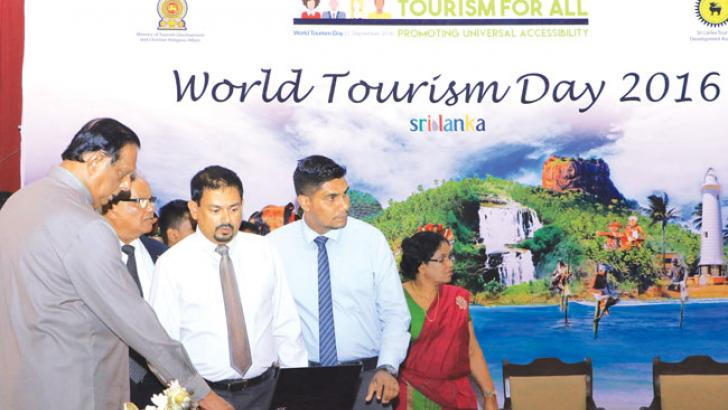 Tourism Development, Christian Affairs and Lands John Amaratunga, Sri Lanka Tourism Development Authority Chairman Paddy Withana and other distinguished officials launching the 'Adaraneeya Sri Lanka' website in Colombo. Picture by Saman Sri Wedage