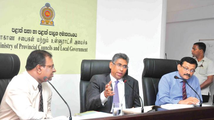 Minister Faiszer Musthapha and other officials at the discussion