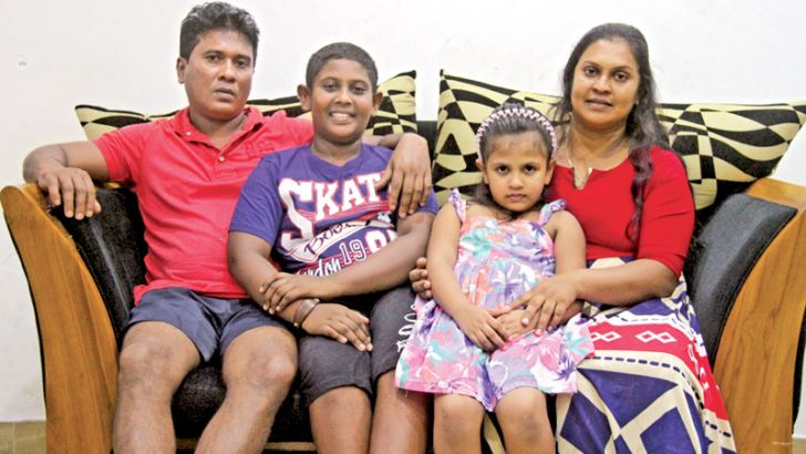 Kesara Godage with his parents and his sister